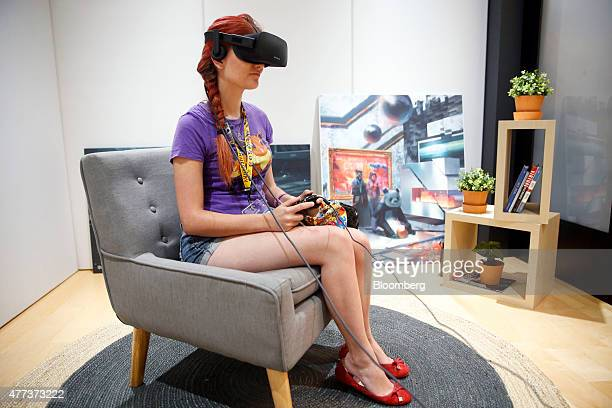 Anna Brisbin plays a video game on an Oculus Rift virtual reality headset during the E3 Electronic Entertainment Expo in Los Angeles California US on...