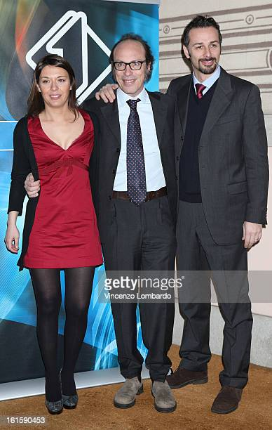 Anna Capella Guido Meda and Alessio Conti attend 'Superbike' and 'Motomondiale' TV Show photocall on February 12 2013 in Milan Italy