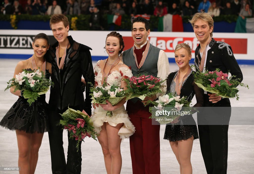 Anna Cappellini and Luca Lanotte of Italy win the gold medal in front of silver medal Elena Ilinykh and Nikita Katsalapov of Russia and bronze medal...