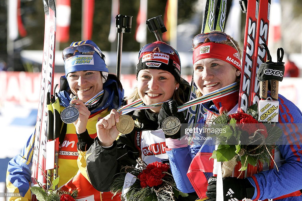 Anna Carin Olofsson of Sweden, second place, Magdalena Neuner of Germany, first place, Natalia Guseva of Russia, third place, celebrate after the IBU Biathlon World Championships Biathlon Ladies Sprint 7.5km event on February 3, 2007 in Antholz, Italy.