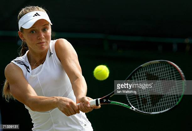 Anna Chakvetadze of Russia returns a backhand to Justin HeninHardenne of Belgium during day five of the Wimbledon Lawn Tennis Championships at the...