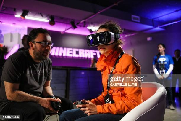 Anna Chif of Diagram wears Oculus goggles and the Samsung Gear VR headset while experiencing Minecraft for Gear VR during a press demonstration in...