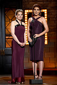Anna Chlumsky and Debra Messing speak onstage during the 2015 Tony Awards at Radio City Music Hall on June 7 2015 in New York City