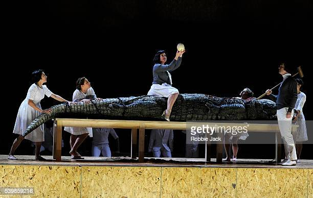 Anna Christy as Cleopatra and Tim Mead as Ptolemy with artists of the company in English National Opera's production of George Frideric Handel's...