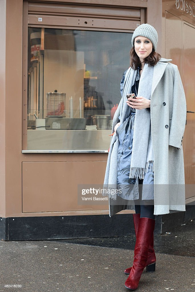 Anna Cleveland poses wearing a Lanvin trench and Hogan shoes during day 4 of Paris Haute Couture Spring Summer 2015 on January 28 2015 in Paris France