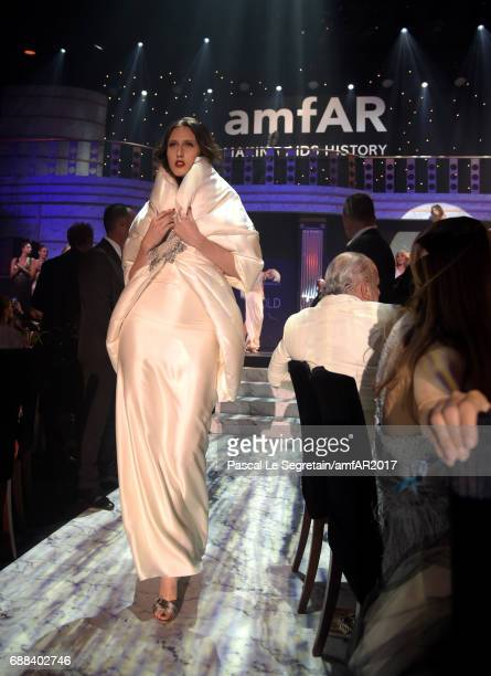 Anna Cleveland wearing Moncler walks the runway in the fashion show during the amfAR Gala Cannes 2017 at Hotel du CapEdenRoc on May 25 2017 in Cap...