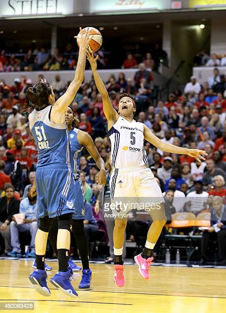 Anna Cruz of the Minnesota Lynx defends the shot of Layshia Clarendon of the Indiana Fever during Game Three of the 2015 WNBA Finals at Bankers Life...