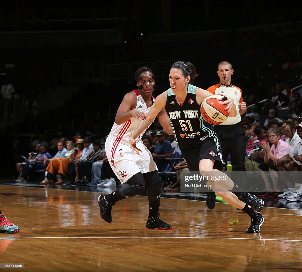Anna Cruz #51 of the New York Liberty handles the ball against the Washington Mystics at the Verizon Center on August 16, 2014 in Washington, DC.
