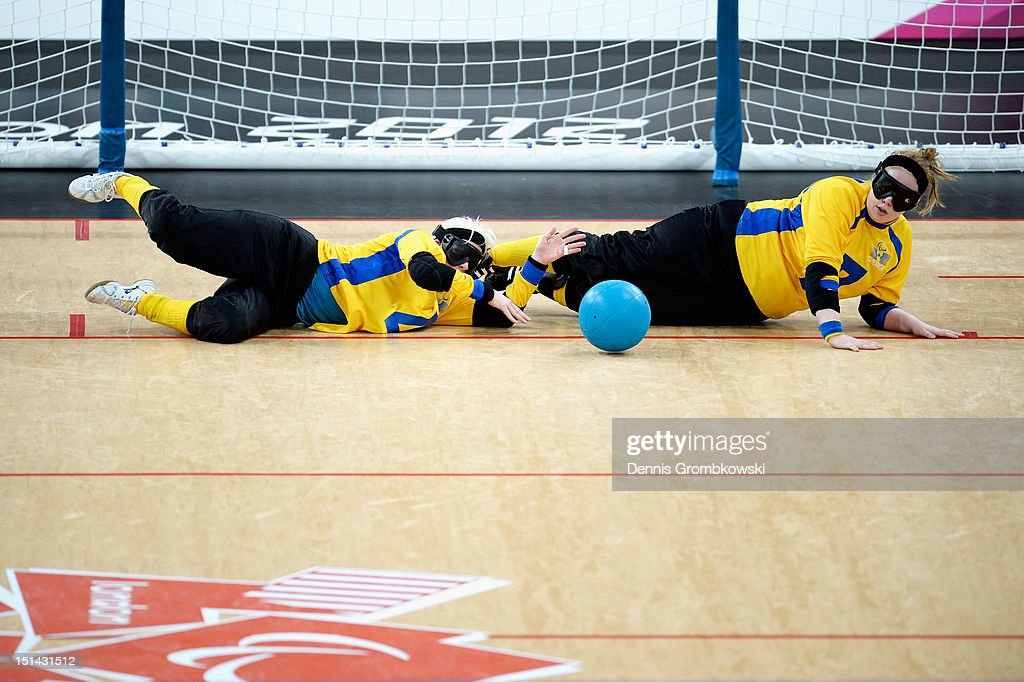 Anna Dahlberg of Sweden and teammate Josefine Jalmestal block the ball during the Women's Team Goalball Bronze Medal match between Finland and Sweden on day 9 of the London 2012 Paralympic Games at The Copper Box on September 7, 2012 in London, England.