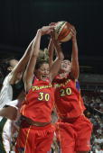 Anna DeForge and Kayte Christensen of the Phoenix Mercury reach for a rebound during the WNBA game against the Seattle Storm at Key Arena on June 7...