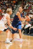 Anna DeForge of the Detroit Shock drives the ball against Erin Phillips of the Connecticut Sun during the WNBA game on July 11 2009 at Mohegan Sun...
