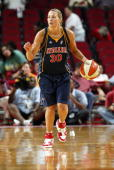 Anna DeForge of the Indiana Fever moves the ball against the Houston Comets during the WNBA game on July 10 2007 at Toyota Center in Houston Texas...