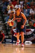 Anna DeForge of the Indiana Fever moves the ball against the Connecticut Sun in Game One of the Eastern Conference Semiinals during the 2007 WNBA...