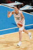 Anna DeForge of the Minnesota Lynx calls a play while driving the ball during the WNBA game against the Phoenix Mercury on May 31 2008 at Target...