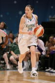 Anna DeForge of the Minnesota Lynx drives the ball up court during the WNBA game against the Los Angeles Sparks on July 27 2008 at Target Center in...