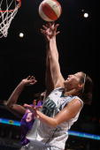 Anna DeForge of the Minnesota Lynx drives to the basket against Barbara Farris of the Phoenix Mercury on September 12 2008 at the Target Center in...