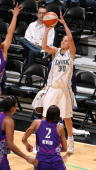 Anna Deforge of the Minnesota Lynx puts up a 3point shot the Sacramento Monarchs on June 12 2008 at the Target Center in Minneapolis Minnesota NOTE...
