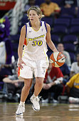 Anna DeForge of the Phoenix Mercury drives upcourt during the WNBA game against the Charlotte Sting at America West Arena on May 16 2003 in Phoenix...