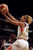 Anna DeForge of the Phoenix Mercury takes the layup during the game against the San Antonio Silver Stars at America West Arena on August 22 2003 in...