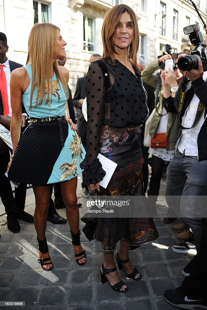 <a gi-track='captionPersonalityLinkClicked' href=/galleries/search?phrase=Anna+Dello+Russo&family=editorial&specificpeople=4391772 ng-click='$event.stopPropagation()'>Anna Dello Russo</a> and <a gi-track='captionPersonalityLinkClicked' href=/galleries/search?phrase=Carine+Roitfeld&family=editorial&specificpeople=240177 ng-click='$event.stopPropagation()'>Carine Roitfeld</a> arrives at Christian Dior Fashion Show during Paris Fashion Week Womenswear Spring/Summer 2014 on September 27, 2013 in Paris, France.