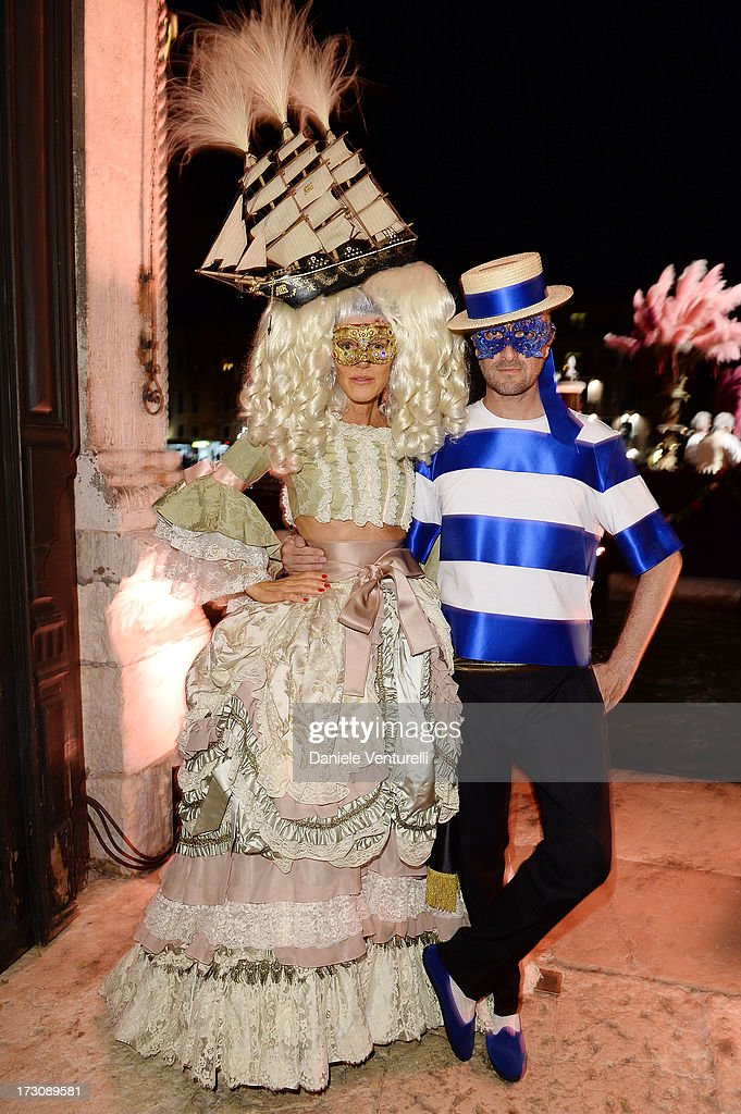 Anna Dello Russo and Marco Braga attend the 'Ballo in Maschera' to Celebrate Dolce&Gabbana Alta Moda at Palazzo Pisani Moretta on July 6, 2013 in Venice, Italy.