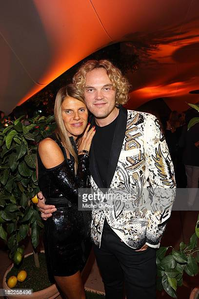 Anna Dello Russo and Peter Dundas attend The Pucci Dinner Party At Monsieur Bleu In Paris on September 28 2013 in Paris France