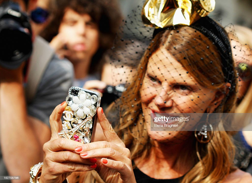 <a gi-track='captionPersonalityLinkClicked' href=/galleries/search?phrase=Anna+Dello+Russo&family=editorial&specificpeople=4391772 ng-click='$event.stopPropagation()'>Anna Dello Russo</a> attends the Blumarine show and wearing a Stephen Jones Millinery and a Alan Journo headpiece during Milan Fashion Week Womenswear Spring/Summer 2013 on September 22, 2012 in Milan, Italy.