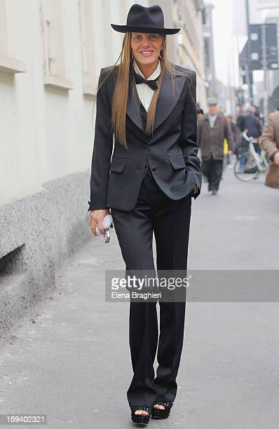 Anna Dello Russo attends the Ermenegildo Zegna show wearing a Ermenegildo Zegna total look during Milan Fashion Week Menswear Autumn/Winter 2013 on...