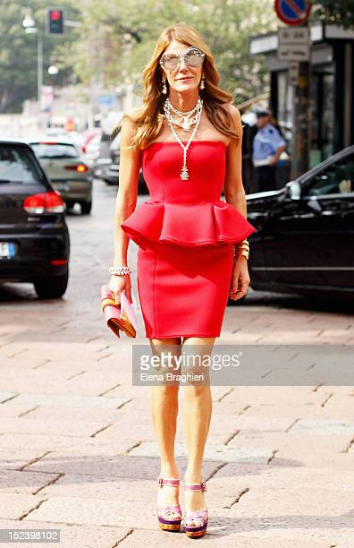 Anna Dello Russo attends the Gucci show in Milan wearing a Lanvin dress Miu Miu shoes Pomellato jewels and Paola Cademartori shoes during Milan...