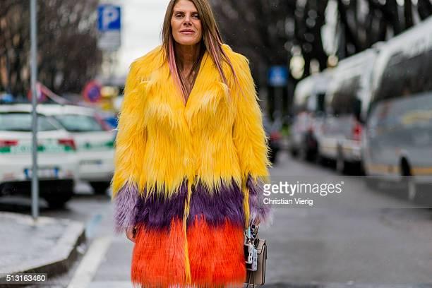 Anna dello Russo is wearing a yellow pruple red fur coat a grey mini Chloe bag seen outside Giorgio Armani during Milan Fashion Week Fall/Winter...
