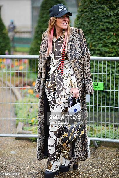 Anna Dello Russo poses before the Moncler Gamme Rouge show at the Grand Palais during Paris Fashion Week FW 16/17 on March 9 2016 in Paris France
