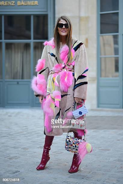 Anna dello Russo poses wearing a Schiaparelli fur Fendi bags and Dior boots before the Schiaparelli show at Place Vendome during Haute Couture on...