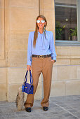 Anna Dello Russo poses wearing Gucci shirt pants and belt and Loewe bag before the Schiapparelli show at Place Vendome on July 6 2015 in Paris France