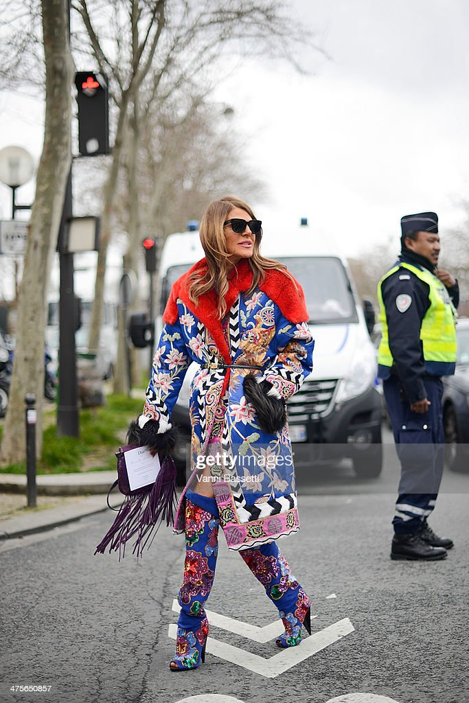 <a gi-track='captionPersonalityLinkClicked' href=/galleries/search?phrase=Anna+Dello+Russo&family=editorial&specificpeople=4391772 ng-click='$event.stopPropagation()'>Anna Dello Russo</a> seen wearing a coat and boots from Tom Ford and a bag from Gucci outside the Dior show on February 28, 2014 in Paris, France.