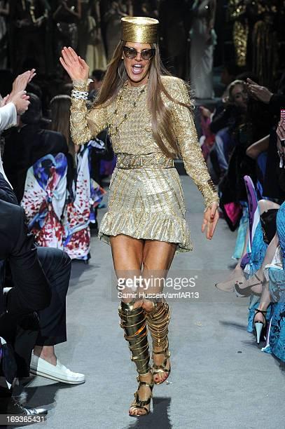 Anna Dello Russo walks during the fashion show runway as part of amfAR's 20th Annual Cinema Against AIDS during The 66th Annual Cannes Film Festival...