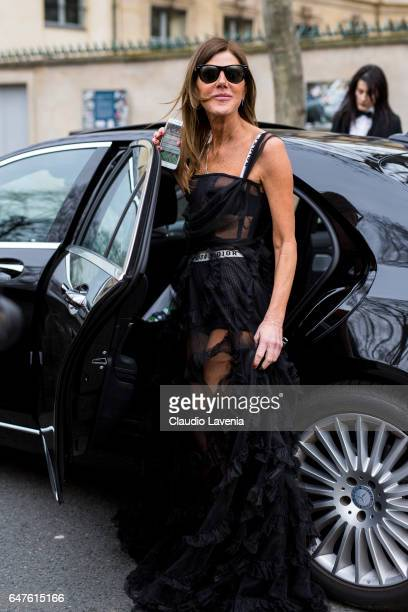 Anna dello Russo wearing a black dress form Dior is seen in the streets of Paris after the Christian Dior show during Paris Fashion Week Womenswear...