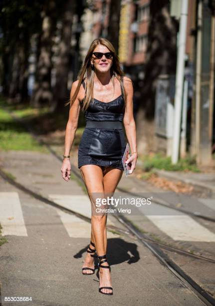Anna dello Russo wearing a black dress is seen outside Dolce Gabbana during Milan Fashion Week Spring/Summer 2018 on September 24 2017 in Milan Italy