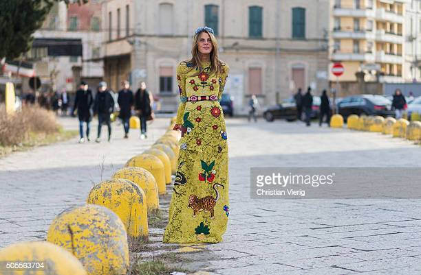 Anna dello Russo wearing a Gucci Cruise 2016 dress outside Gucci during Milan Men's Fashion Week Fall/Winter 2016/17 on January 18 in Milan Italy