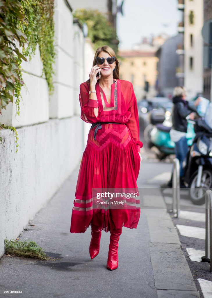 Anna dello Russo wearing a red dress is seen outside Bottega Veneta during Milan Fashion Week Spring/Summer 2018 on September 23, 2017 in Milan, Italy.