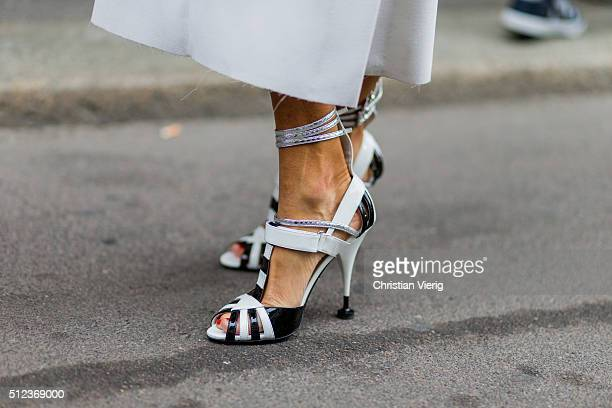 Anna dello Russo wearing a white Proenza Shouler dress with long sleeves and Prada shoes seen outside Max Mara during Milan Fashion Week Fall/Winter...