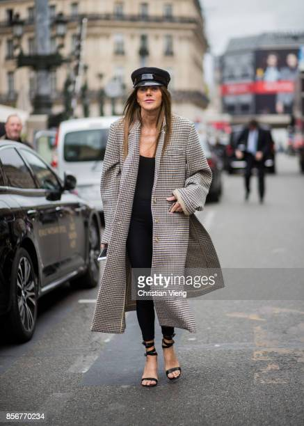Anna dello Russo wearing flat cap checked sweater seen outside Stella McCartney during Paris Fashion Week Spring/Summer 2018 on October 2 2017 in...