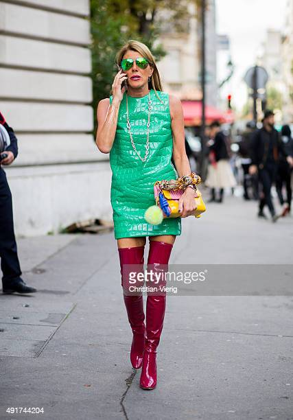 Anna dello Russo wearing Miu Miu dress and bag Dior boots Victoria Beckham sunglasses at Moncler Gamme Rouge during the Paris Fashion Week Womenswear...