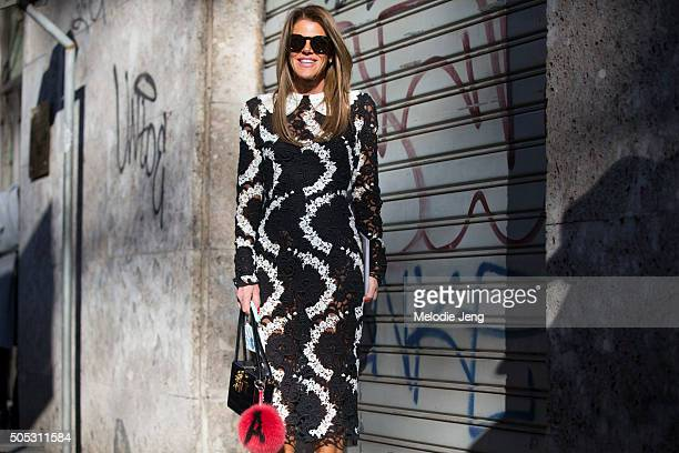 Anna Dello Russo wears a black and white Dolce Gabbana dress with a personalized 'A' fur pom pom during the Milan Men's Fashion Week Fall/Winter...