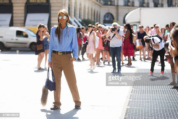 Anna Dello Russo wears a Gucci mens outfit with a Loewe bag at the Schiaparelli show at Hotel d'evreux on July 6 2015 in Paris France