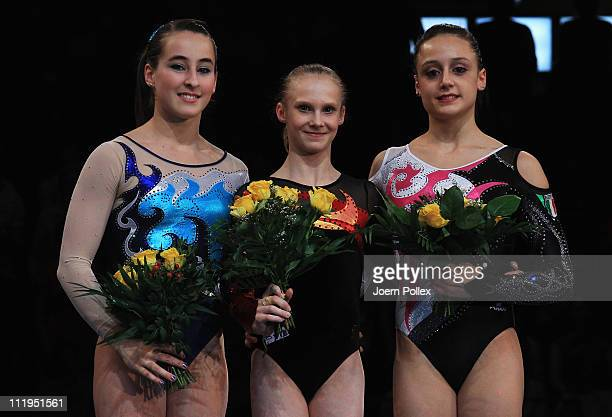 Anna Dementyeva of Russia for first place Carlotta Ferlito of Italy for second place and Elisabetta Preziosa of Italy for third place pose on the...