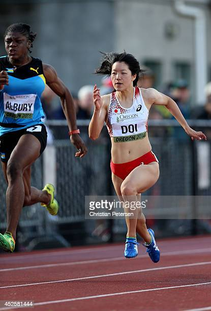 Anna Doi of Japan leads Keianna Albury of the Bahamas down the track in a semifinal of the women's 100m during day two of the IAAF World Junior...