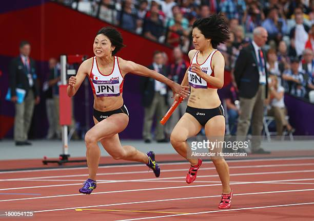 Anna Doi of Japan passes the relay baton to Kana Ichikawa of Japan during the Women's 4 x 100m Relay Round 1 on Day 13 of the London 2012 Olympic...