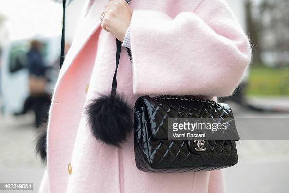 Anna Dolgova poses wearing a Rochas coat and Chanel bag during day 3 of Paris Haute Couture Spring Summer 2015 on January 27 2015 in Paris France