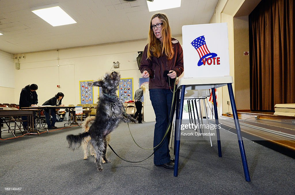 Anna Donlin gives a treat to her dogs Pearl (L) and Walnut after she cast her ballot at Allesandro Elementary School on March 5, 2013 in the Silver Lake area of Los Angeles, California. Turnout is expected to be very low among the city's 1.8 million people, making a run off at the end of May all but certain. Los Angeles City Councilman Eric Garcetti and Controller Wendy Greuel are locked in a close tie for the lead in the Los Angeles mayoral primary. The top two vote-getters will face each other in a run-off in late May.