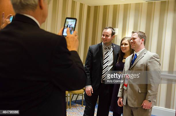 Anna Duggar and Josh Duggar pose during the 42nd annual Conservative Political Action Conference at the Gaylord National Resort Hotel and Convention...